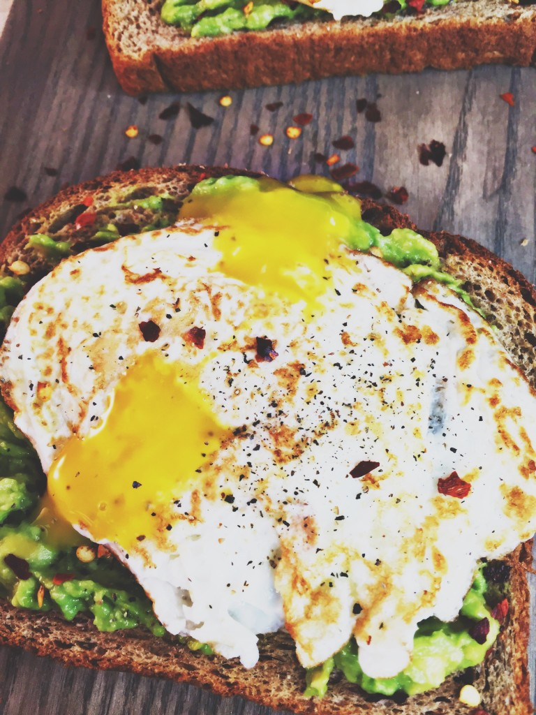 delicious avocado toast with sunny side up egg